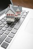 Miniature House on Laptop Computer — Stock Photo