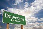 Downtime Just Ahead Green Road Sign  — Stock Photo