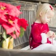 Adorable Little Girl Sitting On Bench with Her Candy Cane — Stock Photo #61437039