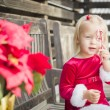 Adorable Little Girl Sitting On Bench with Her Candy Cane — Stock Photo #61437047