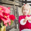 Adorable Little Girl Sitting On Bench with Her Candy Cane — Stock Photo #61437051