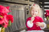 Adorable Little Girl Sitting On Bench with Her Candy Cane — Stock Photo