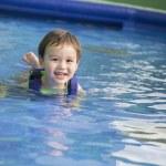 Mixed Race Boy Having Fun at the Water Park — Stock Photo #61735133