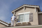 House Painter Painting the Trim And Shutters of Home — Stock Photo