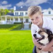 Young Boy and His Dog in Front of House — Stock Photo #62488151