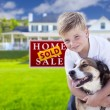 Boy and His Dog in Front of Sold Sign, House — Stock Photo #62488181