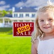 Girl in Yard with Sold Real Estate Sign and House — Stock Photo #62488477