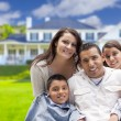 Young Hispanic Family in Front of Their New Home — Stock Photo #62488741