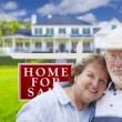 Happy Senior Couple Front of For Sale Sign and House — Stock Photo #62489175