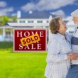 Sold Real Estate Sign with Senior Couple in Front of House — Stock Photo #62489335