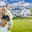 African American Family In Front of Beautiful House — Stock Photo #62489439