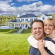Happy Caucasian Couple Hugging In Front of House — Stock Photo #62489497
