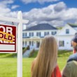 Family Facing Sold For Sale Real Estate Sign and House — Stock Photo #62489623