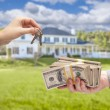 Handing Over Cash For House Keys in Front of Home — Stock Photo #62489767