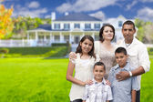 Young Hispanic Family in Front of Their New Home — Stock Photo