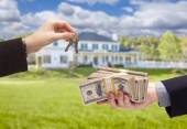 Handing Over Cash For House Keys in Front of Home — Stock Photo