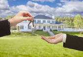 Agent Handing Over House Keys in Front of New Home — Stock Photo