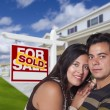 Hispanic Couple, New Home and Sold Real Estate Sign — Stock Photo #62821307