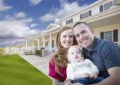 Young Military Family in Front of Beautiful House — Stock Photo
