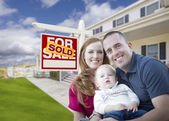 Young Military Family in Front of Sold Sign and House — Stock Photo