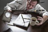 Stressed Man At Desk, Pens, Coffee, Glasses, Clock Flying Up — Stock Photo