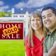 Couple in Front of Sold Real Estate Sign and House — Stock Photo #63026277