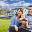 Happy Mixed Race Young Family in Front of House — Stock Photo #63026327
