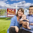 Young Family in Front of Sold Real Estate Sign and House — Stock Photo #63026341