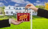 Sold Sign and Agent Handing Over Keys to New Home — Stock Photo
