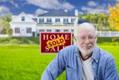 Senior Adult Man in Front of Real Estate Sign, House — Stock Photo