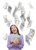 Happy Woman Holding Thousands of Dollars with Many Others Falling Around Her — Stock Photo