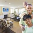 African Amercian Family In Living Room — Stock Photo #64803363