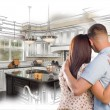 Young Military Couple Inside Custom Kitchen and Design Drawing C — Stock Photo #65099431