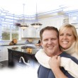 Happy Couple Hugging with Custom Kitchen Drawing and Photo Behin — Stock Photo #65642635