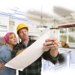 Contractor Discussing Plans with Woman, Kitchen Drawing Photo Be — Stock Photo #65642927