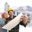 Woman with Contractor Over House Drawing and Photo on White — Stock Photo #65642931
