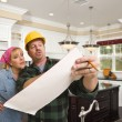 Contractor Discussing Plans with Woman Inside Custom Kitchen Int — Stock Photo #65642939