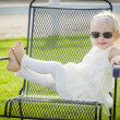 Cute Playful Baby Girl Wearing Sunglasses Outside at Park — Stock Photo #66171187
