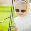 Cute Playful Baby Girl Wearing Sunglasses Outside at Park — Stock Photo #66171151