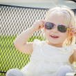 Cute Playful Baby Girl Wearing Sunglasses Outside at Park — Stock Photo #66171165