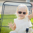 Cute Playful Baby Girl Wearing Sunglasses Outside at Park — Stock Photo #66171169