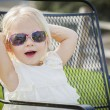 Cute Playful Baby Girl Wearing Sunglasses Outside at Park — Stock Photo #66171193