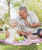 Grandfather and Granddaughter Coloring Easter Eggs on Blanket At — Stockfoto