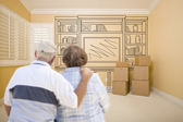 Senior Couple In Empty Room with Shelf Drawing on Wall — Stockfoto