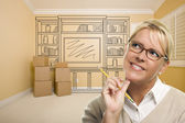 Daydreaming Woman Holding Pencil In Rom with Shelf Drawing on Wa — Stock Photo