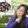 Pensive Woman with Chocolate Candy Inside Thought Bubble — Stock Photo #67843405