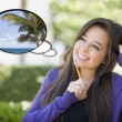 Pensive Woman with Tropical Scene Inside Thought Bubble — Stock Photo #67843453