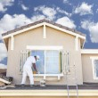 House Painter Painting the Trim And Shutters of Home — Stock Photo #69855623