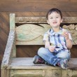 Cute Mixed Race Boy Sitting on Bench Eating Sandwich — Stock Photo #69856239