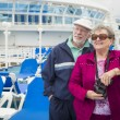 Senior Couple Enjoying The Deck of a Cruise Ship — Stock Photo #71537129